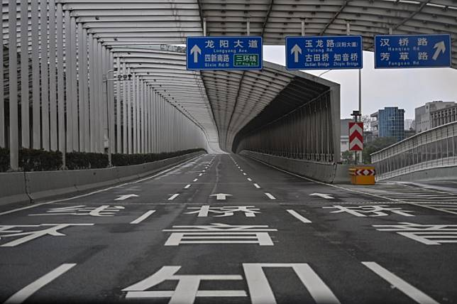 An empty road is seen in Wuhan in China's central Hubei province on Jan. 27, 2020, amid a deadly virus outbreak which began in the city.