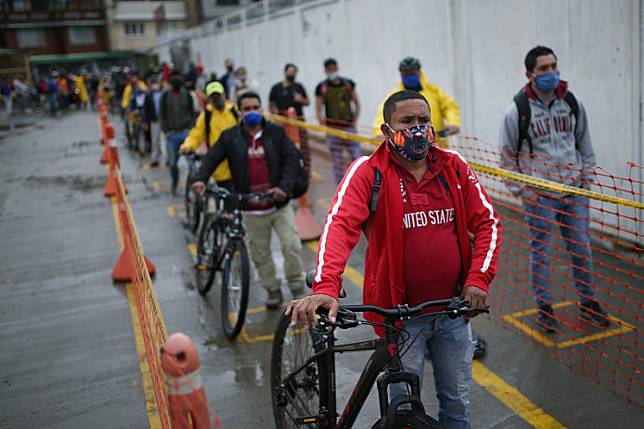 Employees of the Amarilo construction company stand within the marks of social distancing, amid the coronavirus disease (COVID-19) outbreak in Bogota, Colombia May 19, 2020.
