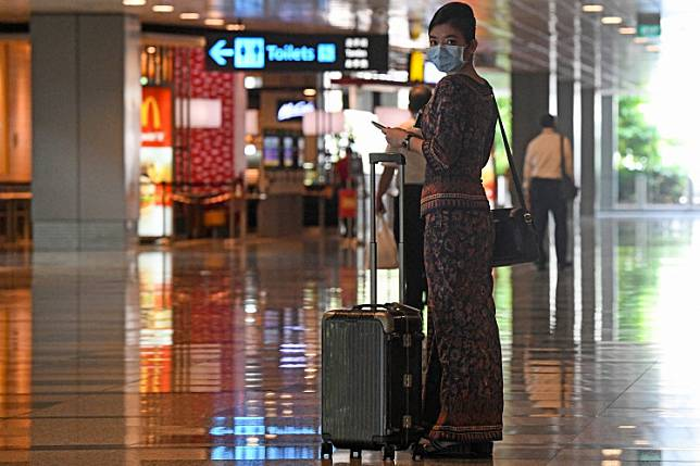 A Singapore Airlines stewardess returns from a flight at Changi International Airport terminal in Singapore on June 8, 2020, as Singapore prepares to reopen its borders after shutting them to curb the spread of the COVID-19 novel coronavirus. Singapore and Malaysia are to resume essential business and official travel between their countries, they said on Tuesday, letting people cross their border for the first time since most movements were suspended because of the coronavirus in March.