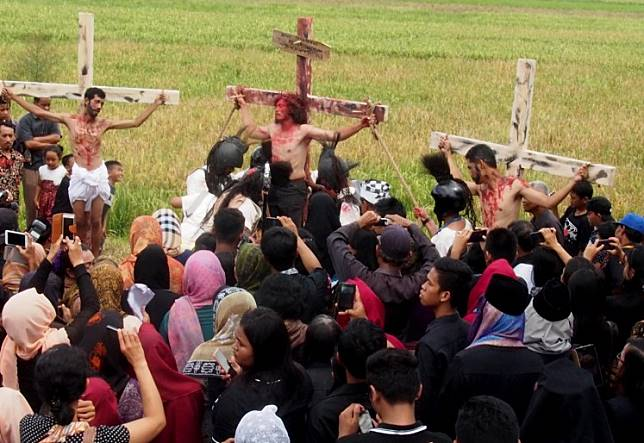 Catholic performers from the Ngolodono Church in Karangdowo, Klaten, Central Java, hold a ritual depicting the crucifixion of Jesus Christ on Good Friday.