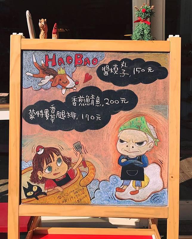 圖說:這是少數保留下來的黑板畫,陳昕以主題「奈良美智」的風格,畫出在店內工作的爸爸及媽媽。陳昕提供