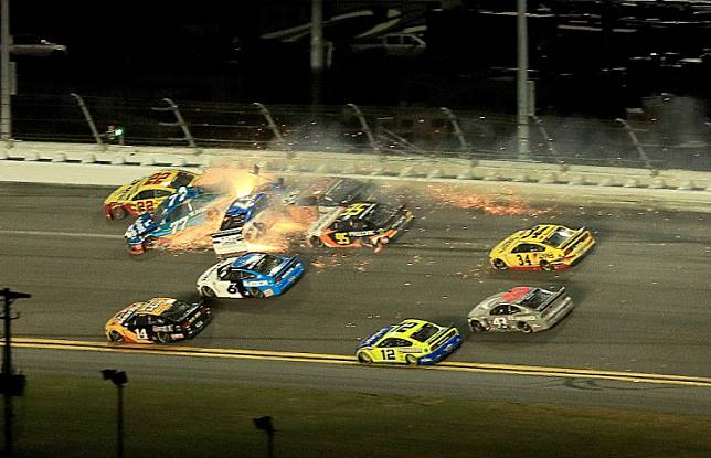 DAYTONA BEACH, FLORIDA - FEBRUARY 17: Ross Chastain, driver of the #77 AdventHealth Chevrolet, crashes during the NASCAR Cup Series 62nd Annual Daytona 500 at Daytona International Speedway on February 17, 2020 in Daytona Beach, Florida. Mike Ehrmann/Getty Images/AFP