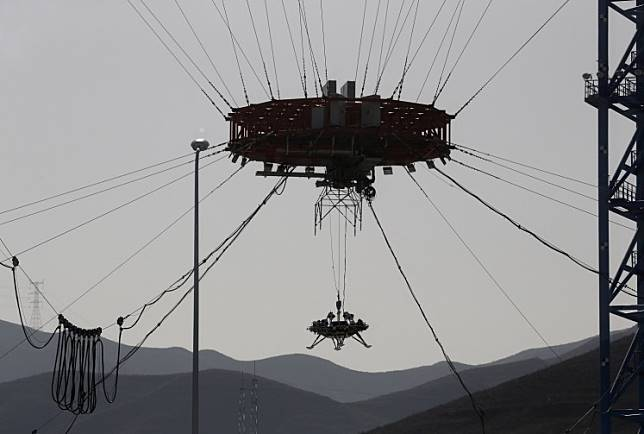 A lander for China's Mars mission is seen after a hovering-and-obstacle avoidance test at a test facility in Huailai, Hebei province, China, on November 14, 2019.
