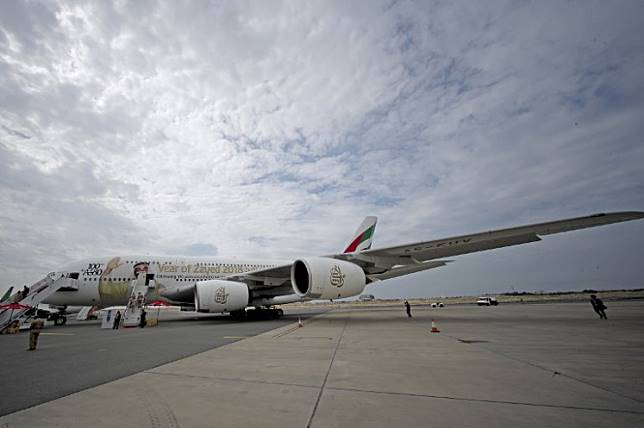 This picture shows the 100th Emirates Airline double-decker Airbus A380, the world's largest passenger aircraft, during the 2018 Bahrain International Airshow (BIAS) at the Sakhir Airbase, south of the Bahraini capital Manama on November 14 2018.