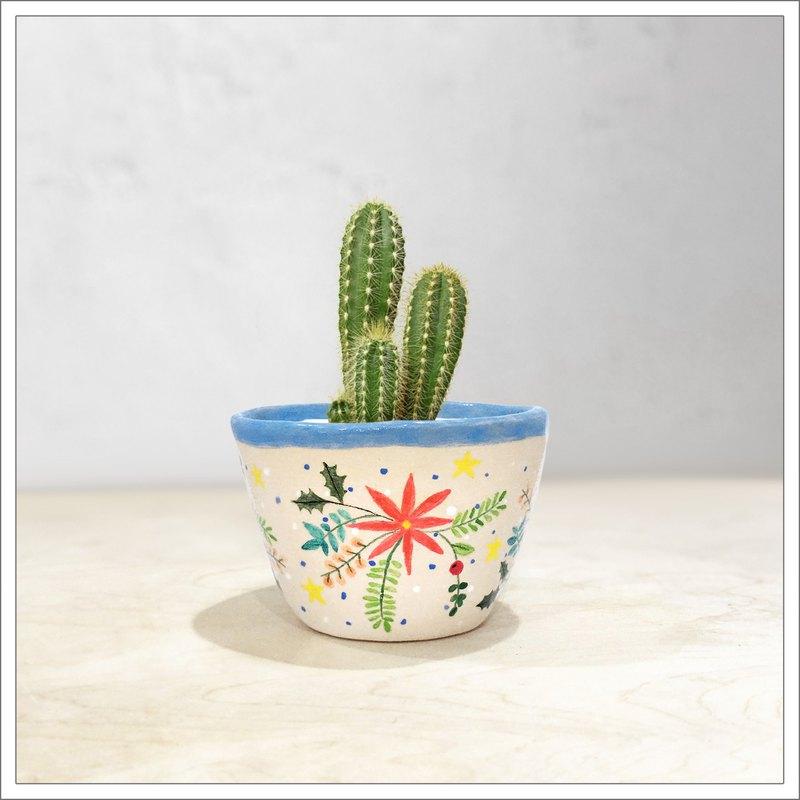 在聖誕節聖手/多肉植物/仙人掌/植物/花上捏捏並塗上陶瓷鍋