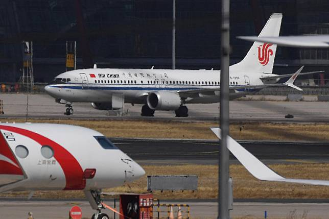 An Air China Boeing 737 MAX 8 plane is seen at Beijing Capital Airport on March 11, 2019.Washington on Wednesday ordered the suspension of all flights by Chinese airlines into and out of the United States after Beijing failed to allow American carriers to resume services to China.