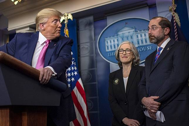 US President Donald Trump (left) turns to address US Secretary of Health Alex Azar (right) as he speaks during a news conference on the COVID-19 outbreak at the White House on Feb. 26, 2020.The United States has decided to postpone a meeting with leaders of Southeast Asian countries it had planned to host on March 14 due to worries about the coronavirus outbreak.