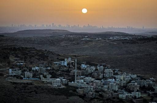 A picture taken from the Israeli settlement of Naale in the occupied West Bank northwest of the Palestinian city of Ramallah shows the skyline of the Israeli coastal city of Tel Aviv on June 17, 2020.The Palestinian Authority on Wednesday announced a five-day lockdown across the West Bank after a rise in coronavirus infections, as Israel saw its steepest-yet 24-hour uptick in cases.