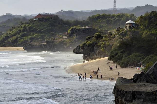The picturesque Indrayanti Beach in Gunungkidul, Yogyakarta.