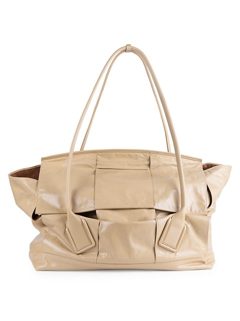 Woven leather bag with graceful, curved top handles and an oversized, slouchy silhouette.; Dual top