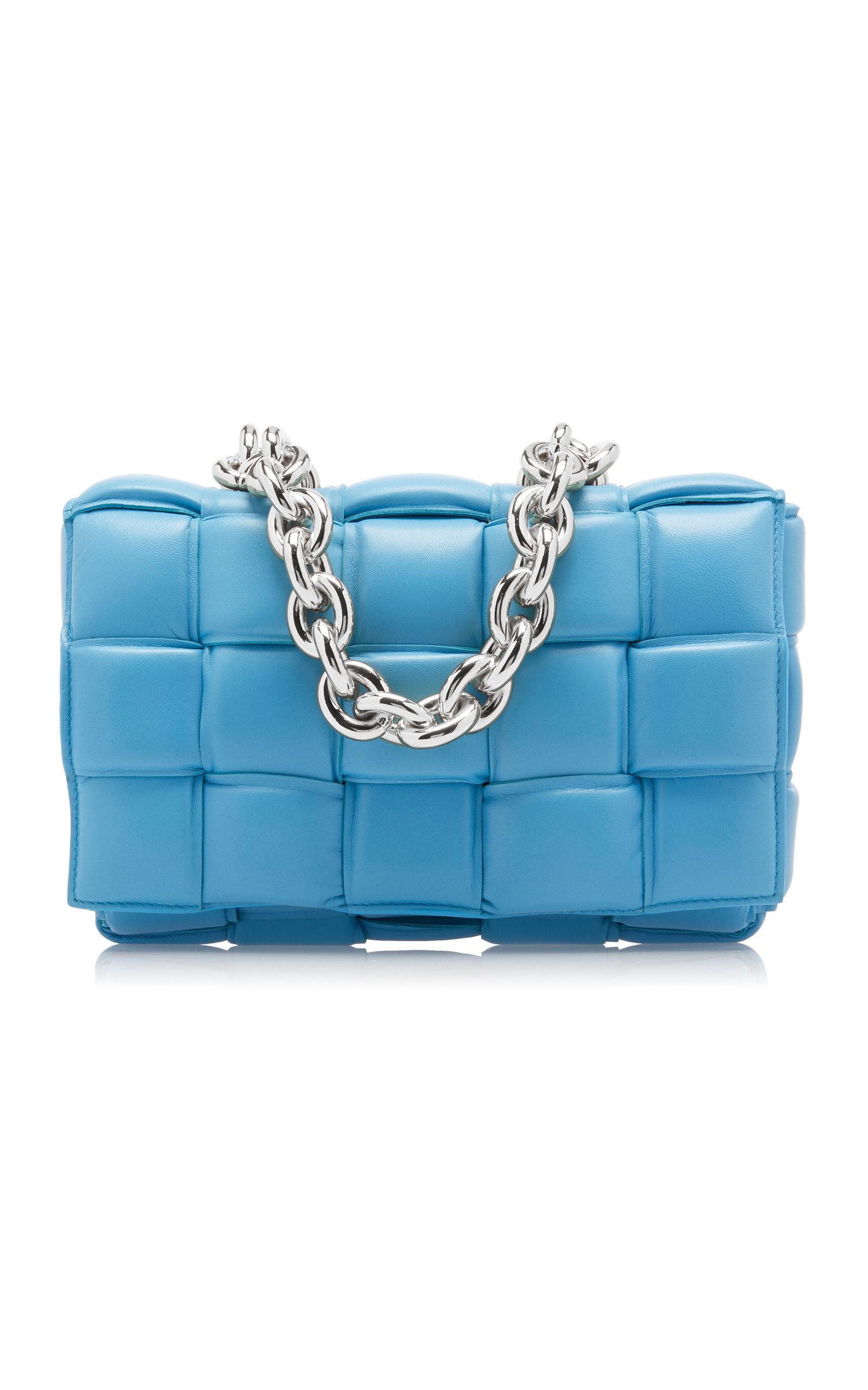 Woven using Bottega Veneta's distinguished intrecciato technique, this vivid blue crossbody bag is c