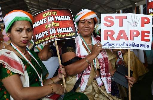 "Supporters of President of the Indian National Congress Party Rahul Gandhi hold placards in reaction to the recent rape cases in India during a rally dubbed ""Jan Aakrosh Rally"" (public outrage), in New Delhi on April 29, 2018. The rally was Gandhi's first in the national capital since taking over as the party chief last year. The rally was called to launch a protest against Prime Minister Narendra Modi government's ""failures and corruption""."