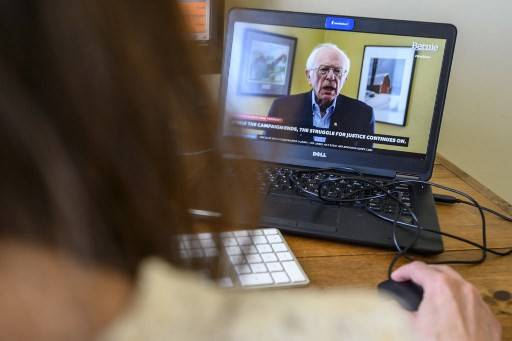 An AFP political correspondent working from home watches a video from the Bernie Sanders presidential campaign, as Sanders announces the suspension of his presidential campaign on Wednesday, in Washington.