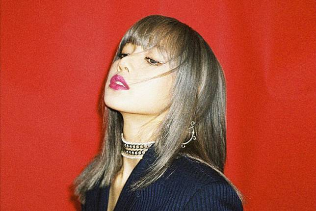 BLACKPINK's Lisa. YG Entertainment released a statement that Lisa has been swindled by her former manager.