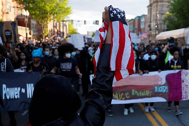 Protestors rally against the death in Minneapolis police custody of George Floyd in Boston