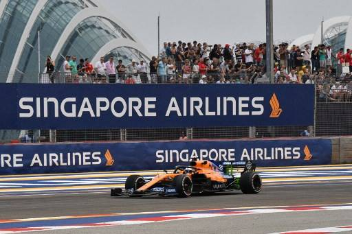 McLaren's Spanish driver Carlos Sainz Jr takes part in the first practice session for the Formula One Singapore Grand Prix at the Marina Bay Street Circuit in Singapore on September 20, 2019. While the fate of this year's Singapore Airlines Singapore Grand Prix remains up in the air, preparations are under way for it to go ahead with a live audience.