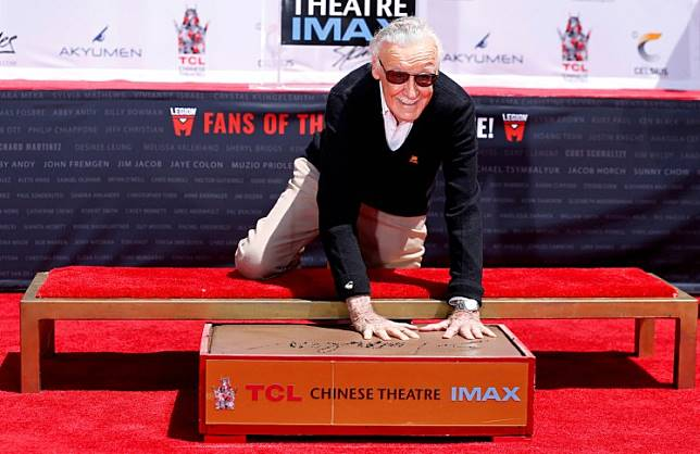 Marvel Comics co-creator Stan Lee places his handprints in cement during a ceremony in the forecourt of the TCL Chinese theatre in Los Angeles, California, U.S., July 18, 2017.