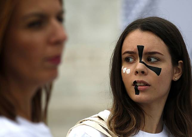 Fashion fights facial recognition systems via garish make-up, face-printed T-shirts, punk hair extensions