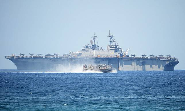 A US Navy hover craft speeds past the USS Wasp, US Navy multipurpose amphibious assault ship, during the amphibious landing exercises as part of the annual joint US-Philippines military exercise on the shores of San Antonio town, facing the South China sea, Zambales province on April 11, 2019.Two US Navy aircraft carriers are conducting exercises in the contested South China Sea within sight of Chinese naval vessels spotted near the flotilla, the commander of one of the carriers, the USS Nimitz, told Reuters on Monday.