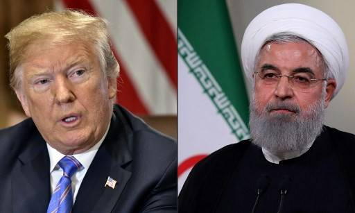 This combination of file pictures created on July 23, 2018 shows US President Donald Trump during a cabinet meeting on July 18, 2018, at the White House in Washington, DC, and a file handout picture provided by the Iranian presidency on May 2, 2018 on showing President Hassan Rouhani giving a speech on Iranian TV in Tehran. The White House said on September 15, 2019 President Donald Trump may still meet his Iranian counterpart Hassan Rouhani, despite the US accusing Iran of masterminding drone attacks on Saudi Arabian oil facilities. White House counselor Kellyanne Conway did not rule out the possibility in a television interview broadcast as Saudi Arabia raced to restart operations at oil plants hit by drone attacks that slashed its production.