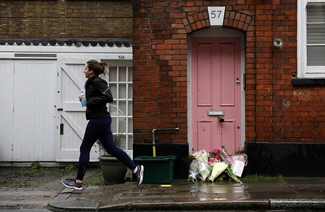 Flowers lie outside British television presenter Caroline Flack's old house in Islington, London, on February 16, 2020.