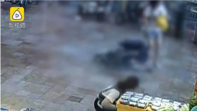 深圳日前發生一起意外,一名6歲男童和母親走在路上,突然遭大片玻璃砸中。(圖/翻攝自梨視頻)