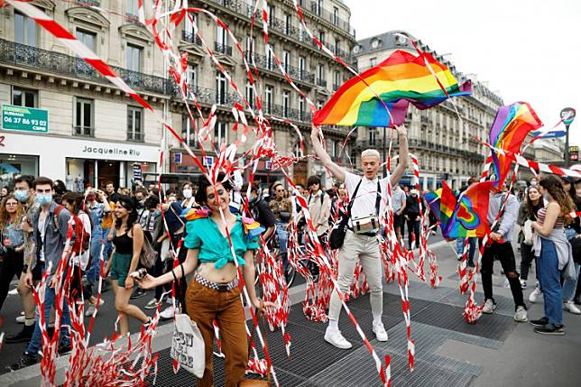 People attend Paris' LGBT march despite social distancing restrictions forbidding gatherings of more than 10 people in Paris, France, July 4, 2020.