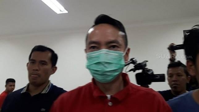 Andy Wibowo (baju merah) ditangkap karena kasus koboi jalanan. (Suara.com/Arga).