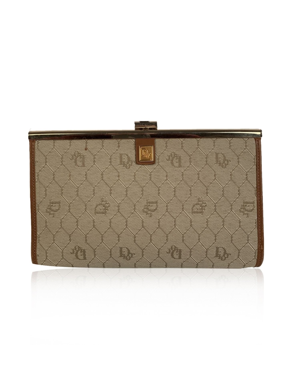 Vintage CHRISTIAN DIOR beige logo canvas with tan leather trim. Clasp closure on top. Beige leather