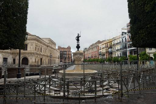Picture shows dismantled grandstands that should be used during upcoming Holy Week celebrations in an empty Plaza de San Francisco in Seville, on March 14, 2020. - Seville decided today to cancel its famous Holy Week processions, scheduled for April 5 to 12, due to the spread of the novel coronavirus, COVID-19, in Spain, local authorities announced.