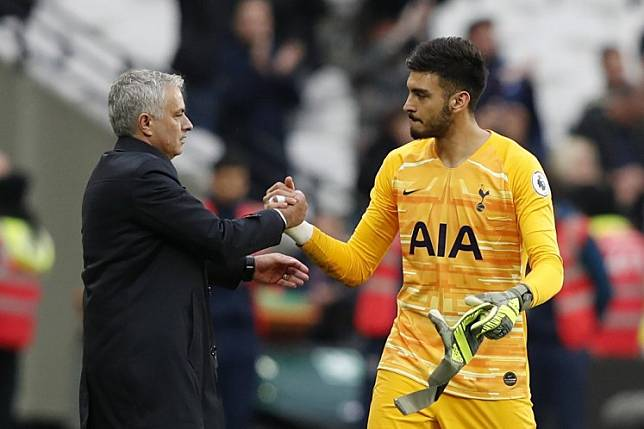 Tottenham Hotspur's head coach Jose Mourinho (left) reacts with goalkeeper Paulo Gazzaniga at the final whistle during their English Premier League soccer match against West Ham United at The London Stadium, in London on Nov. 23, 2019. The Spurs beat West Ham United 3-2.