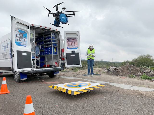 An employee of Sincronia Logistica looks at a drone loaded with personal protective gear and other essential equipment for delivery at a public hospital, in Queretaro, Mexico June 26, 2020.