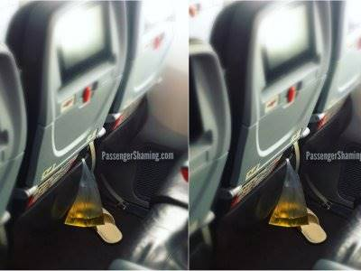 Jorok! Bungkus Plastik Berisi Pipis Ditinggal di Bangku Pesawat