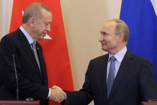 Russian President Vladimir Putin (right) and his Turkish counterpart Recep Tayyip Erdogan shake hands during a joint press conference following their talks in the Black sea resort of Sochi on October 22, 2019.