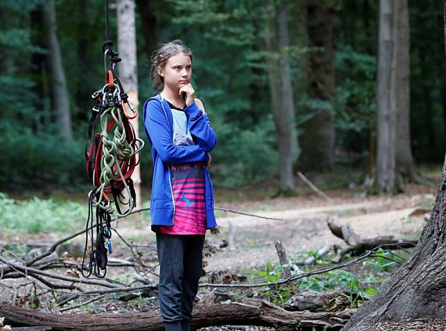 Greta Thunberg, Swedish 'Fridays for Future' climate activist, stands next to climbing equipment that hangs from an illegal tree house in the Hambach Forest that is supposed to be chopped away for the nearby open-cast brown coal mine of German utility RWE, west of Cologne, Germany, on August 10, 2019.