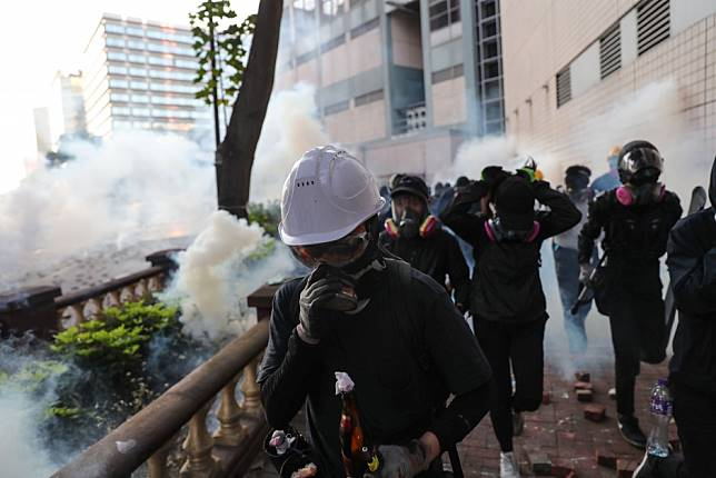 Hong Kong protests: radicals and police locked in tense stand-off at Polytechnic University
