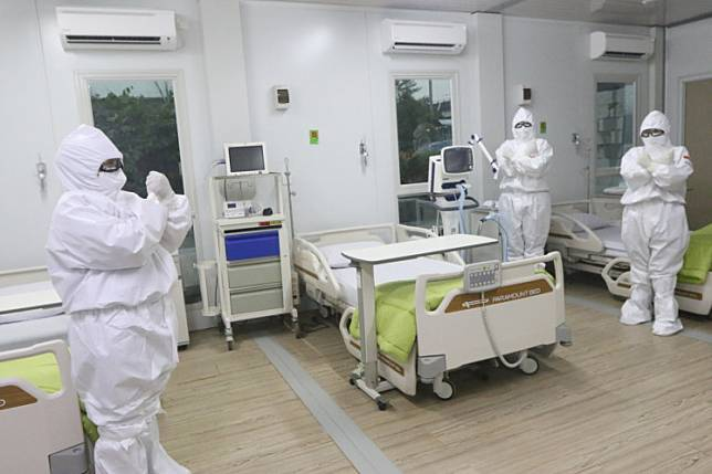 Gearing up: Medical staff check a room prepared for COVID-19 patients at Pertamina Jaya Hospital in Cempaka Putih, Jakarta.