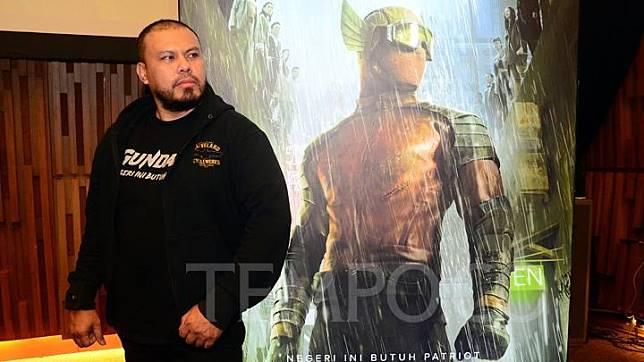 Film director Joko Anwar poses in front of a Gundala poster in Jakarta, May 28, 2019. Gundala is set to premiere at cinemas nationwide on August 29, 2019. TEMPO/Nurdiansah