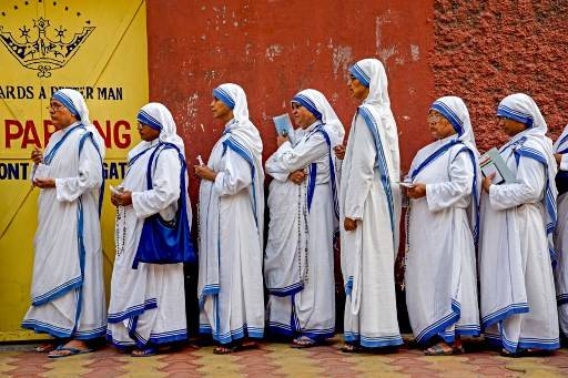 Indian nuns from the Mother Teresa Missionaries of Charities queue to cast their votes at a polling station at St. Mary's School in Kolkata on May 19, 2019, during the 7th and final phase of India's general election. Voting in one of India's most acrimonious elections in decades entered its final day on May 19 as Hindu nationalist Prime Minister Narendra Modi scrambled to hang on to his overall majority.