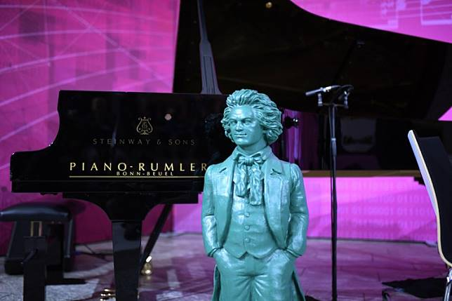 A statue of Beethoven by German artist Ottmar Hoerl stands in front of a piano during a presentation of a part of the completion of Beethoven's 10th symphony made using artificial intelligence at the Telekom headquarters in Bonn, western Germany, on Dec. 13, 2019. Telekom supports an experiment to complete the composer's 10th symphony using artificial intelligence and a team of international experts from science and music. A string quartet and a pianist perform two minutes of the AI composition live.