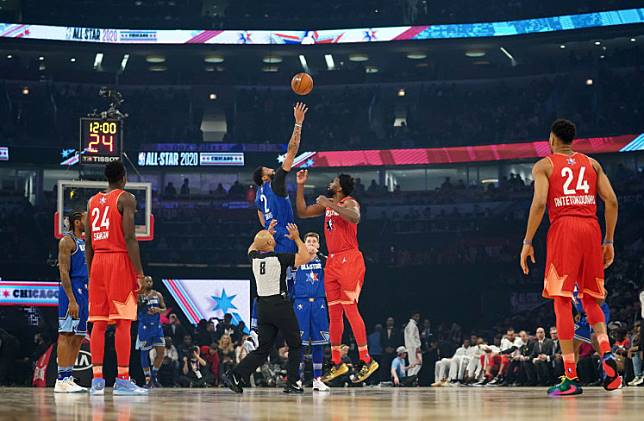 Team Giannis center Joel Embiid of the Philadelphia 76ers and Team LeBron forward Anthony Davis of the Los Angeles Lakers go up for the opening tip in the first quarter during the 2020 NBA All Star Game at United Center on Sunday