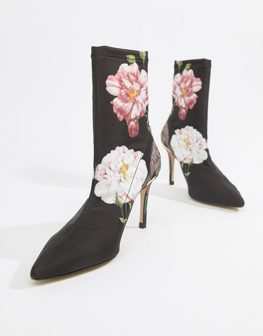 Boots by Ted Baker They've already got your attention Signature floral print Pull-on style Stretchy,