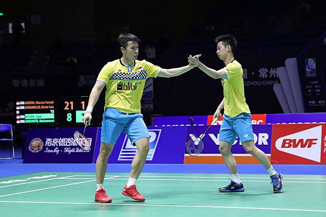 Indonesia's Marcus Fernaldi Gideon (left) celebrates with partner Kevin Sanjaya Sukamuljo after earning a point during the 2019 China Open men's doubles semifinal match against compatriots Fajar Alfian and Muhammad Rian Ardianto (not pictured) in Changzhou, China, on Sept. 21, 2019. Marcus and Kevin advanced to the final.