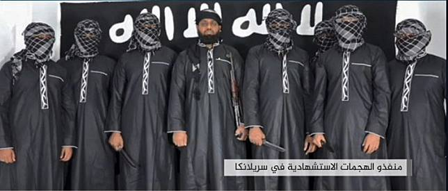 An image grab taken from a press release issued on April 23, 2019 by the Islamic State (IS) group's propaganda agency Amaq, allegedly shows eight men it said carried out a string of deadly suicide bomb blasts on Easter Sunday in Sri Lanka, lined up at an undisclosed location. The man in the centre is believed to be Zahran Hashim, who was identified by the Sri Lankan police as the leader of the Islamist National Thowheeth Jama'ath (NTJ) group, which Colombo has blamed for the attacks. The Islamic State group claimed a series of bombings on churches and luxury hotels in Sri Lanka that killed more than 320 people on April 21, and released the photo of the men it said were behind the