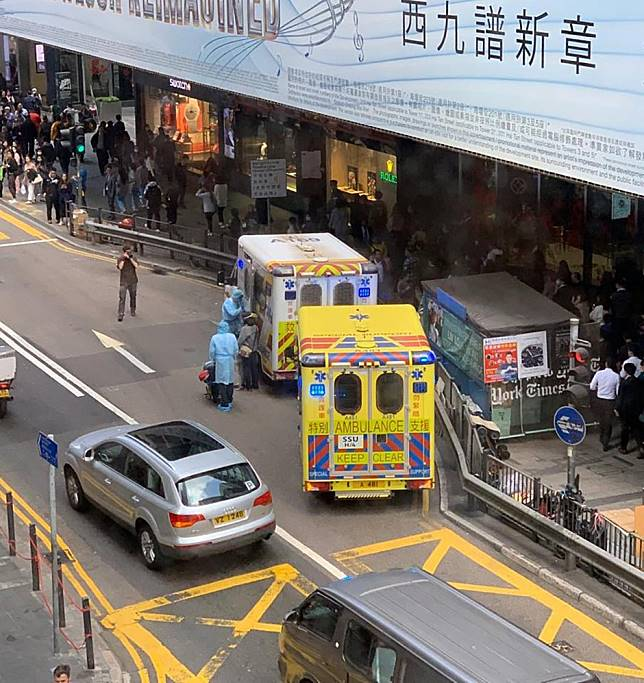 China coronavirus: panic sweeps through Hong Kong business district after medical staff in full protective gear are seen taking woman to waiting ambulance