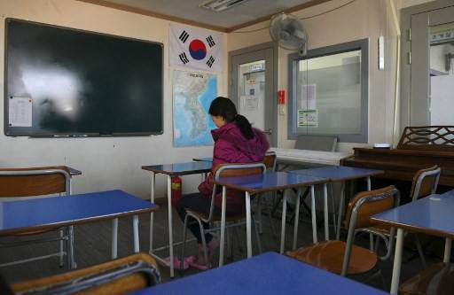 This picture taken on March 22, 2019 shows Lee Song-hee, a 27-year-old North Korean defector, during an interview with AFP at Wooridul School in Seoul, an educational haven for North Korean defectors too old to go to appropriate state schools. Some 60 students are enrolled at the school, one of seven special-purpose academies across the country, offering defectors free education that its principal says is