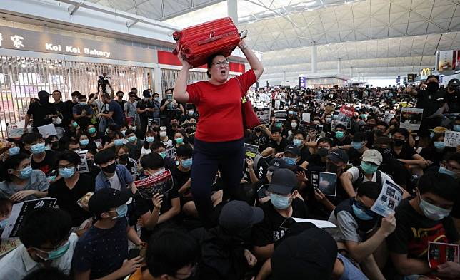 Hong Kong protests: traveller numbers at city airport in biggest drop since 2009 as unrest batters tourism