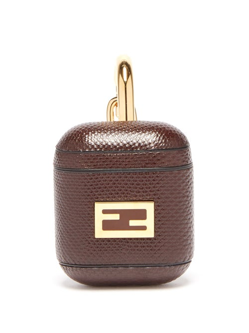 Fendi - Fendi's lends a typically luxurious tone to everyday accessories, such as this brown AirPods case. Crafted in Italy, it's made with a plastic case that's layered with brown snakeskin that's hallmarked with the iconic FF logo plaque, then adorned with a gold carabiner clasp at the hinged lid.