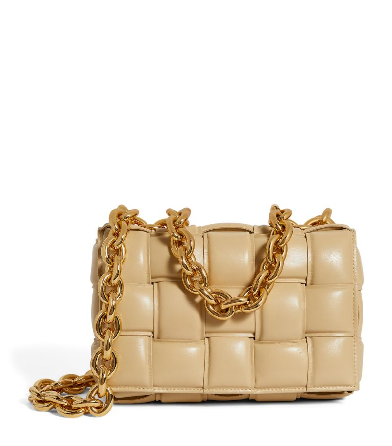 Its difficult to define which aspect of the Bottega Veneta Chain Cassette bag is the most luxurious. On the one hand, the buttery texture of the leather construction is impossible to resist - even more so thanks to the rich tone with which its rendered - yet, on the other hand, the chain strap exudes the opulence of jewellery combined with the authority of its chunky, heavyweight style. Carry it daily to reach your own conclusion.
