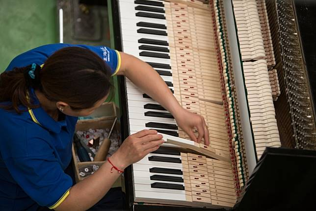 Chinese love to play piano, even if their locally made instruments keep hitting bum notes